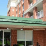 Metal soffit and standing seam